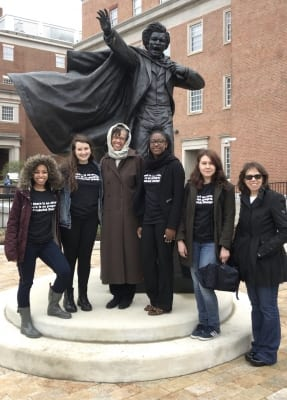 Rosenker Center faculty and UMD students with statue of Federick Douglass